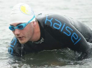 Sam competing in triathlon
