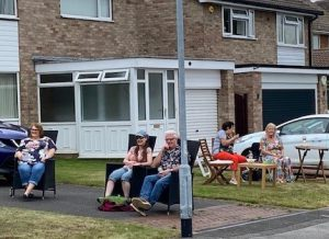 residents enjoying the music from their driveways
