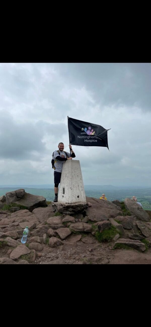 at summit with flag